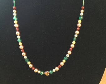 Necklace with colored pearls and glass heart