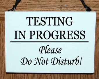 Testing in progress please do not disturb wood door hanger sign