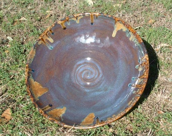 Large shallow sliptrailed blue stoneware bowl