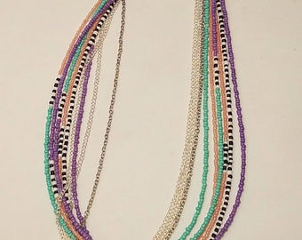 Multi-strand beaded necklace with chain.
