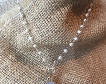 St. Benedict Medal on Silver tone toggle front Wire wrapped pearl necklace