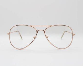 Gold aviator glasses, clear lens metal teardrop spectacles. metal frame vintage 80s style eyeglasses. Prescription, optical frames. Aviators