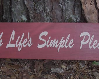 Cherish Life's Simple Pleasures, Antiqued Red Paint made from reclaimed wood, 24 inches by 4 1/2 inches.