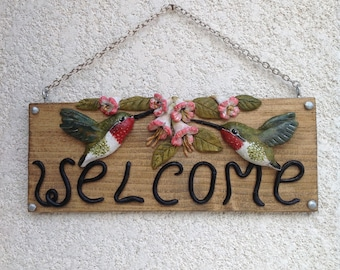 Hummingbirds welcome sign