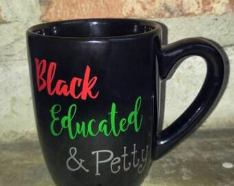 Black, educated, & petty coffee mug