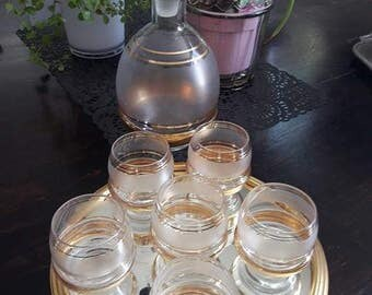 Old gold liqueur service with tray