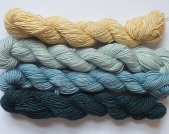 set of mini skeins of merino single yarn, dyed with natural material, indigo, oak