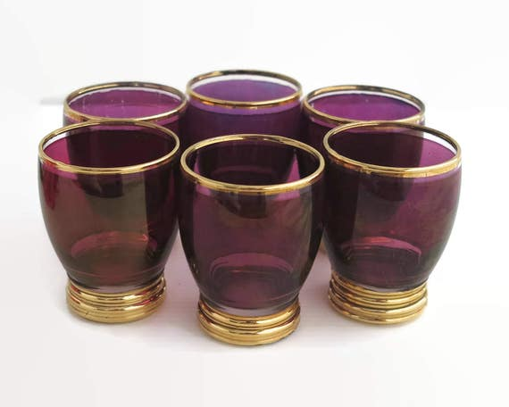 6 ruby red glass shot or liqueur glasses in deep pinkish purple color with lashings of gilt trim, iridescent, mid 20th century