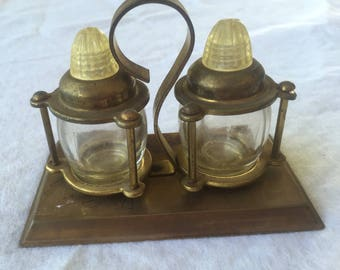 Vintage clear glass Salt Shakers with Gold Tone metal top and base stand