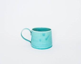 turquoise porcelain coffee mug