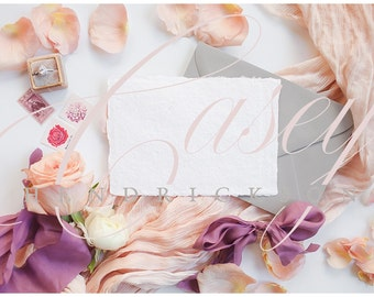 Horizontal deckled edge paper wedding stationery with envelope stock photo mockup mock pic with peach and purple tones and roses