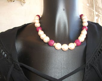RAS neck in large natural pearls.