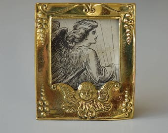 Beautiful miniature antique brass photograph frame photo holder decorated with an angel