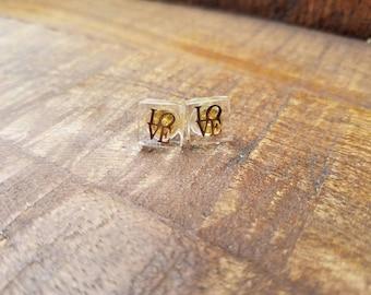 Gold LOVE resin stud earrings