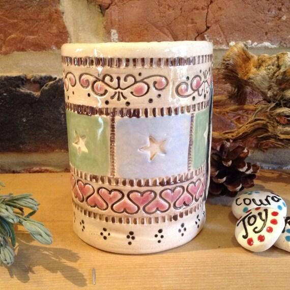 Handmade ceramic vase, patchwork feel, vintagey, richly patterned, stitchy detail