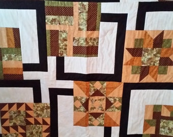 Brown and gold sampler quilt