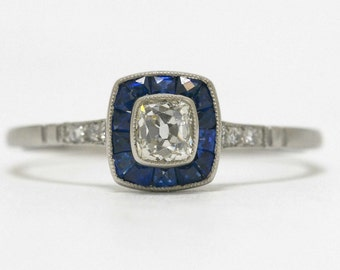 Lovely Antique Cushion Cut Diamond Engagement Ring Surrounded By Sapphires Accent Halo Art Deco Platinum Milgrain Small Size