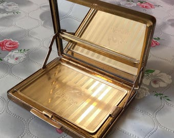 Vintage Stratton compact mirror, wiper compact, self cleaning mirror, 1950s powder compact in hand goldtone self opening inner lid miraclean