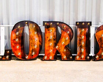 Any 7 Marquee letter sign with globe bulbs, single sign bracket, in the font and finish of your choice. UL listed sockets weatherproof