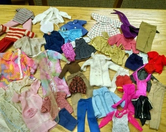 variety of doll clothes for barbie type dolls
