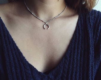 Beautiful elegant beaded chain with silver crescent pendant