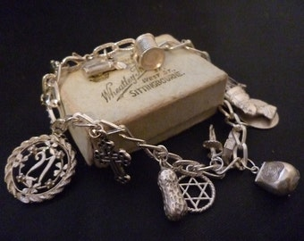 Vintage sterling silver charm bracelet - 925 - Heavy - 14 charms - 7 inch