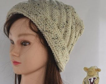 Lady's knitted hat - beanie style with a ruched pattern - natural colour with brown flecks