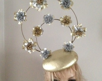 Gold leather perching beret hat adorned with halo's of silver & gold hand sculptured leather flowers.