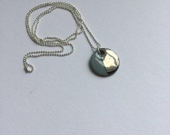 Platinum lustre pendant