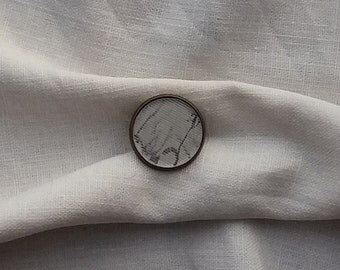Lenticular Brooch, round, small, silver, black and white image that changes