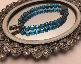 Cathedral Style Rectangle Sapphire Blue & Silver Faceted glass beaded flexible bracelet with a Hematite Heart and Silver Buddha Head Charm.