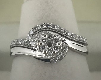 A Pair of White Gold and Diamond Matching Engagement and Wedding Rings