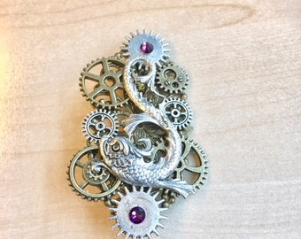 "PIN steampunk ""silverfish"" with workings and Swarovski Crystal purple"