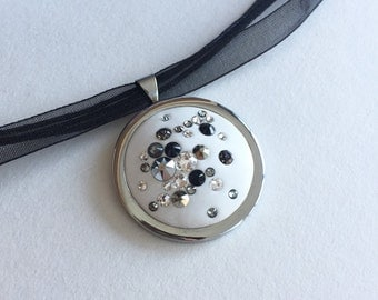 Steel and Swarovski® rhinestone pendant