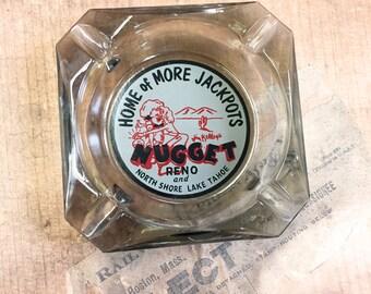 "Nugget Reno & North Shore Lake Tahoe ""Home of More Jackpots"" Novelty Ashtray Glass"