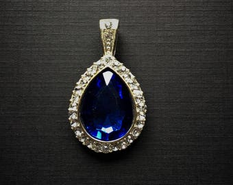 Beautiful Pendant-Sapphire Blue Center surrounded by White Crystals