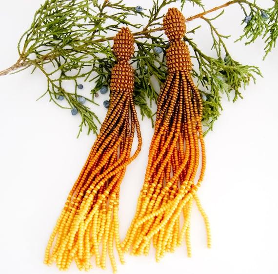 Long tassel earrings yellow mustard beaded earrings oscar for Mustard colored costume jewelry