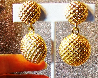 Very bright and shiny gold earrings.