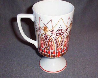 Art Deco Design Ceramic Pedestal Mug, White with Orange and Browns