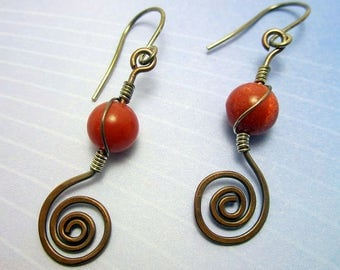 Copper and silver earring with a reddish bead