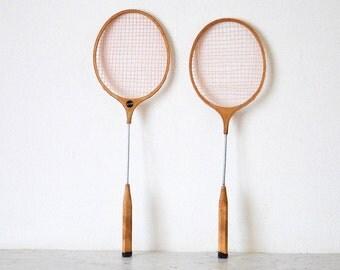 Very elegant pair of old badminton rackets in natural blond wood