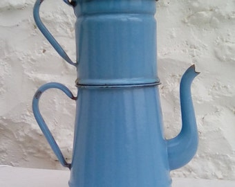 A vintage  enamelware coffee pot, cafetière, blue.