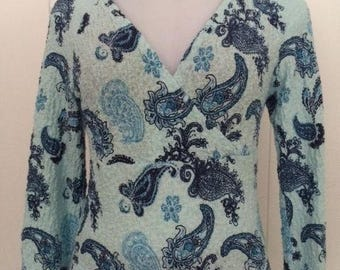 Paisley print stretch fabric/crossed bodice top with bell sleeves