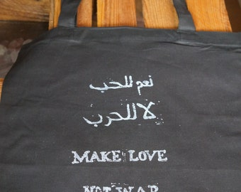 Make love not war! English and arabic statement at a bag
