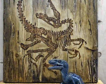 Rustic dinosaur skeleton burned on pallet wood