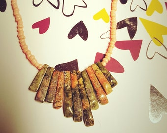 Necklace featuring pink and green stones