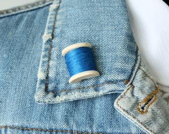 Blue Bobbin Lapel Pin - half a wooden bobbin with real thread
