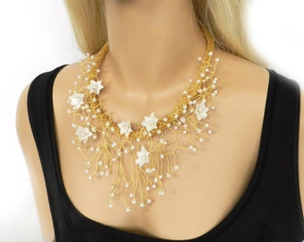 Gold tone bib necklace with white pearls and flowers, wire crochet necklace