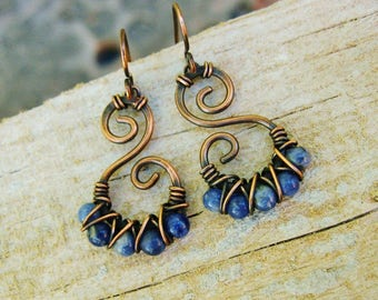 Hammered Copper Swirls with Blue Sodalite beads criss cross wire wrapped in antiqued copper dangle earrings
