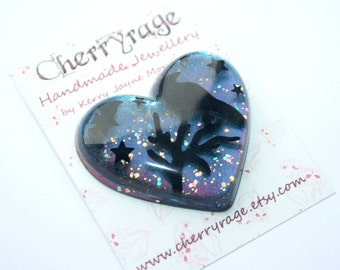 Large heart brooch with a silhouette bird on a branch, bat and stars, on a glittery, twinkly night sky
